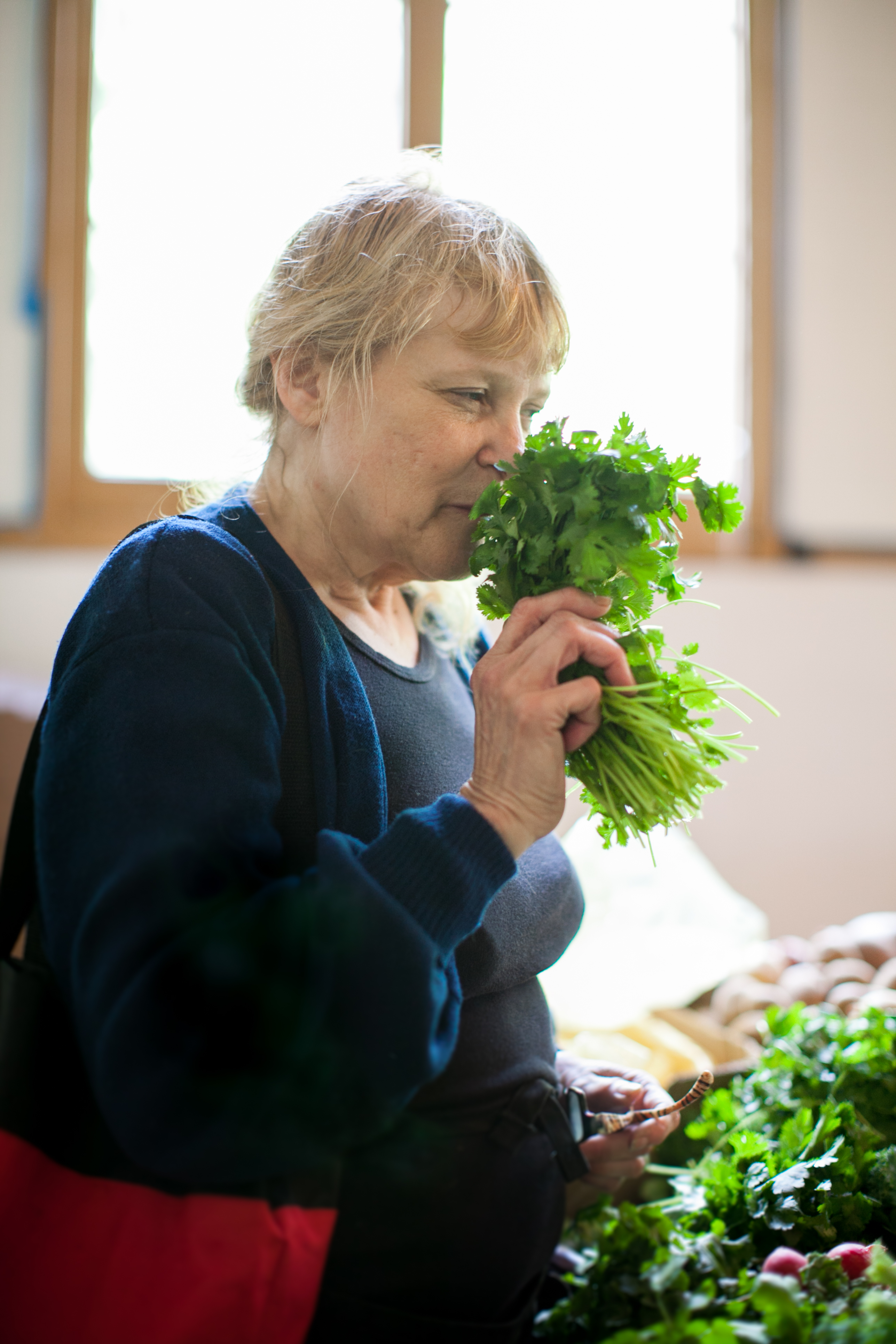 woman smelling cilantro
