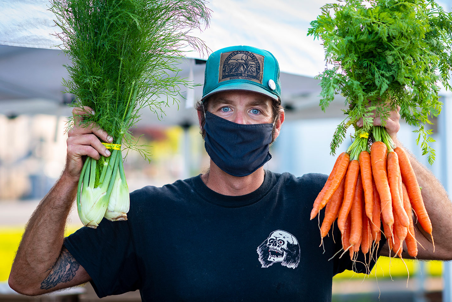 Justin Moore in mask with carrots and fennel